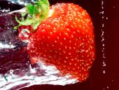 Ripe Strawberry Swimming Through Water