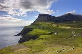 Faroe Islands, Remote Village On Steep Cliffs Overlooking The Sea