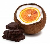 Orange Inside Coconut And Pieces Of Chocolate Isolated On White