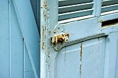 stock photo of jalousie  - Blue wooden jalousie door with locking device in Provence in France - JPG