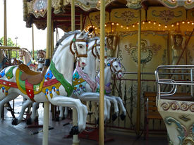 stock photo of merry-go-round  - Paris with an old Merry go round near the Tuileries garden - JPG
