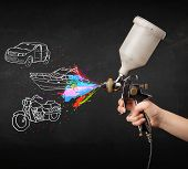 picture of airbrush  - Man with airbrush spray paint with car - JPG
