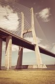 Vasco da Gama bridge in Lisbon, Portugal with retro effect applied.