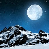 Breithorn and Klein Matterhorn in the night sky with moon