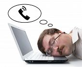 Employee At The Computer Dreaming That He Call
