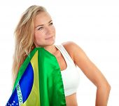 Portrait of cute admirer of Brazilian football team with their national flag isolated on white backg