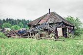 Old small abandoned and ruinous country house in Russia