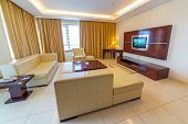 ABU DHABI, UAE - MARCH 30: Luxury living room of The Grand Midwest Tower Hotel in Dubai on 30 March