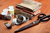Close-up sewing tools on wooden background vintage style