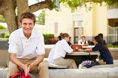 stock photo of playground school  - Portrait Of Male High School Student Wearing Uniform - JPG