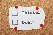 stock photo of thinker  - Tick Boxes for Thinker or Doer on a piece of paper pinned to a cork notice board - JPG