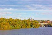 Fall colors of Potomac riverside and Key Bridge Washington DC.