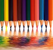 Colorful pencils arranged as a color pallete with abstract reflection. Concepts of creativity, art, school etc.