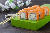 Sushi roll with red salmon and philadelphia cheese