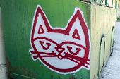 Old Dumpster with cat face graffiti