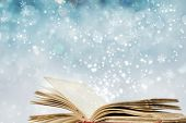Christmas fairy-tale. Christmas background with magic book poster