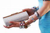 purse & jewelery in hand