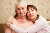 Senior woman with their caregiver at home.