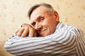 Portrait of senior man relaxing at home