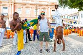 BAHIA, BRAZIL - CIRCA NOV 2014: A group of people playing Capoeira. Capoeira is a Brazilian martial art that combines elements of dance, acrobatics and music, and is sometimes referred to as a game.