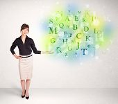 Business women with green glowing letter concept