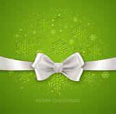 Green Christmas background with white silk bow