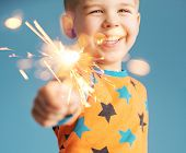 stock photo of boys night out  - Smiling boy holding fireworks - JPG