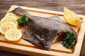 picture of flounder  - Fresh raw flounder on cutting board - JPG