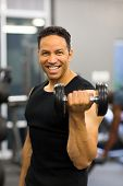 portrait of athletic man excising with dumbbells