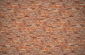 old dark brown and red brick wall for texture and background