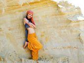 Woman wearing in asian style in desert landscape