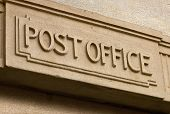 pic of old post office  - Post Office Building entrance carved in stone above the door of the postal service - JPG