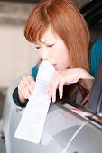 picture of vomiting  - concept shot of young Japanese woman vomiting by car sickness - JPG