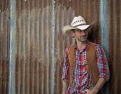 Cowboy Leans against a wall