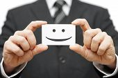 stock photo of smiling  - our clients are happy clients smile on business card - JPG