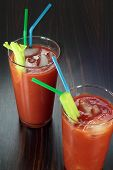 stock photo of bloody mary  - Bloody Mary cocktail on a veneered counter top - JPG