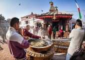People Praying Near Bodnath Stupa