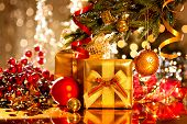 image of christmas eve  - Christmas gift box and baubles - JPG