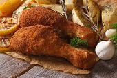 Fried Chicken Leg In Batter With Potatoes