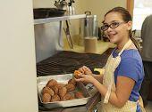 Young Girl Preparing Sweet Potatoes