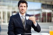 Portrait of a businessman drinking a coffee