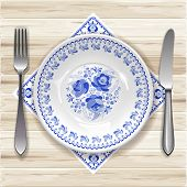 image of bordure  - White plate with russian ornament in gzhel style on wooden table - JPG