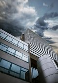 Modern skyscraper buiseness building stormy sky background