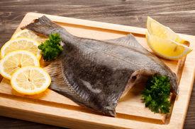 foto of flounder  - Fresh raw flounder on cutting board - JPG