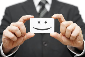 stock photo of joining  - our clients are happy clients smile on business card - JPG