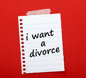 image of divorce-papers  - The phrase I want a Divorce written on a lined paper note taped to red notice board - JPG
