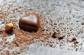 picture of chocolate-chip  - Chocolate heart in chocolate chips on a black background - JPG