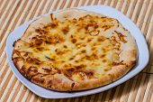 picture of furnace  - Hot Tasty bread cake with yellow cheese made in fire furnace of bakery - JPG