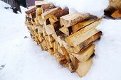 image of firewood  - Firewood in snow outdoors - JPG