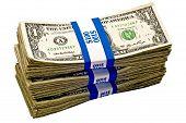 foto of bundle  - Horizontal shot of three big bundles of cash separated by paper bands - JPG